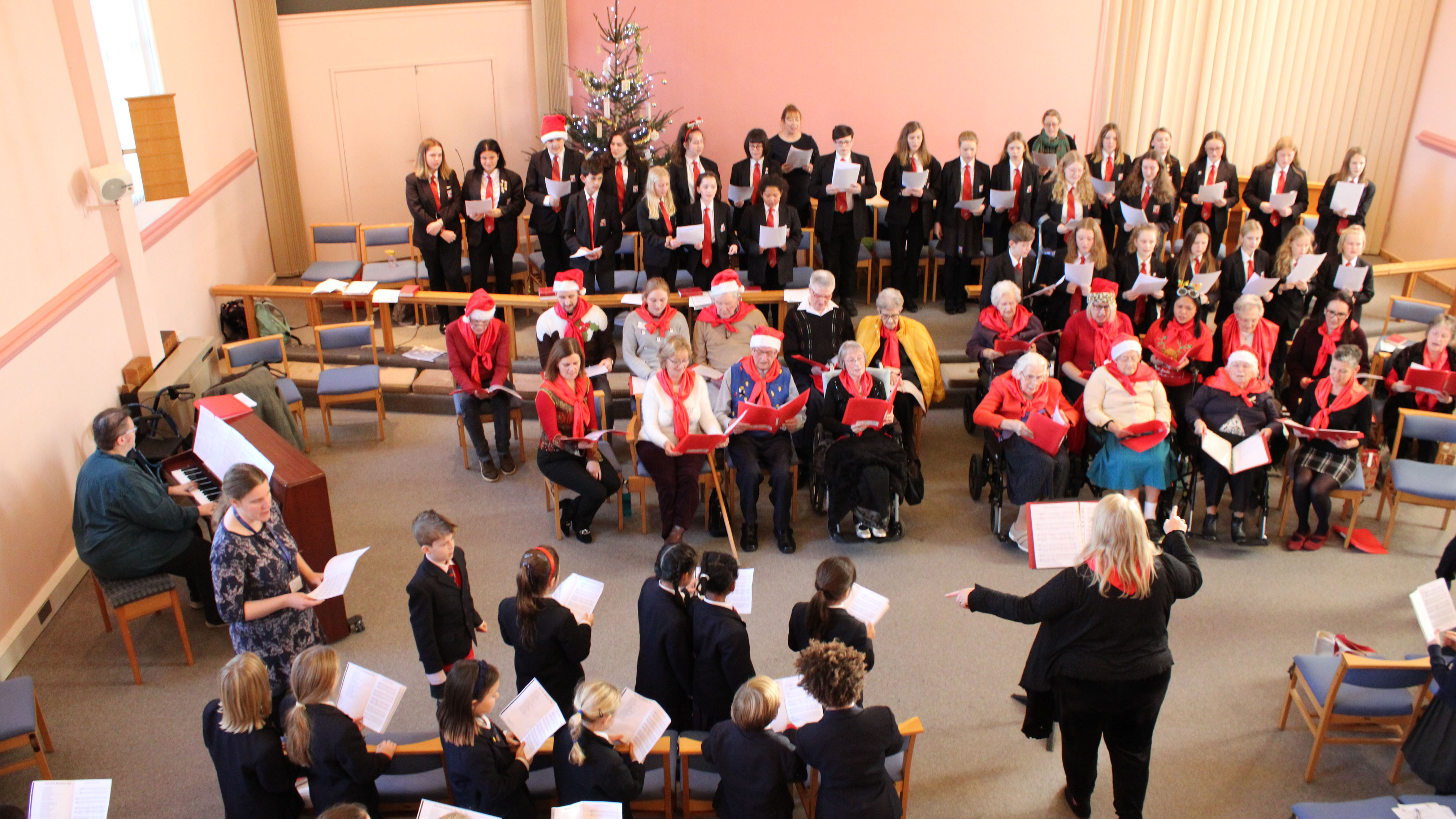 Festive fun enjoyed by young and old at the Woodbridge Combined Care Homes Choir Christmas Concert